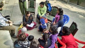 A student teaching Bible stories in Nepal.